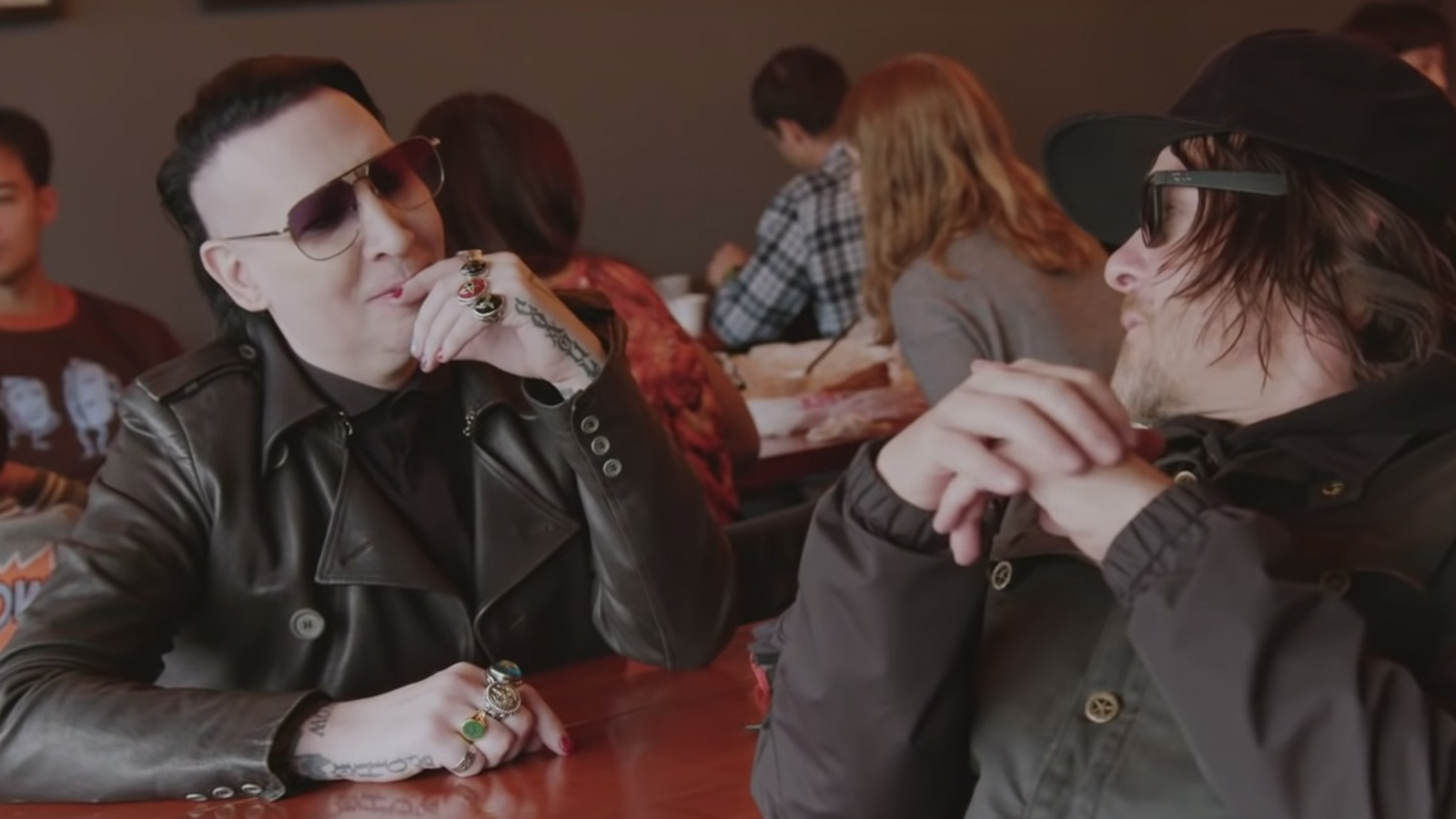 See Marilyn Manson, Norman Reedus Eat Hot Chicken, Ride Motorcycle, Talk Arrests