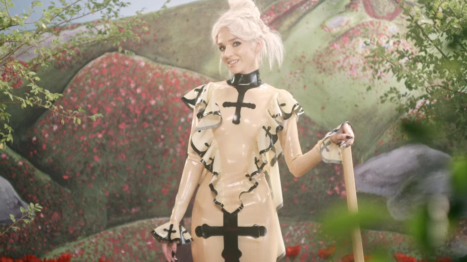 "Slipknot Meets Bubblegum Pop: Watch Poppy Dig Graves in Crazy New ""Concrete"" Video"