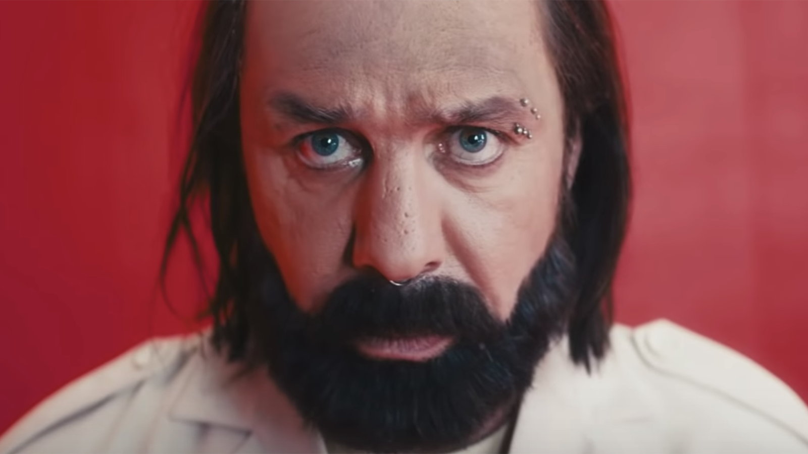 """See Till Lindemann Face Off With Peter Stormare in Insane New """"Steh Auf"""" Video"""