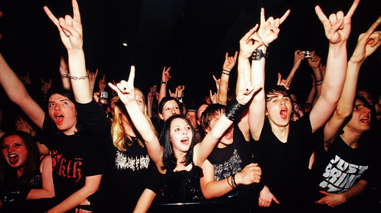 metal fans crowd mosh pit, PYMCA/UIG via Getty Images